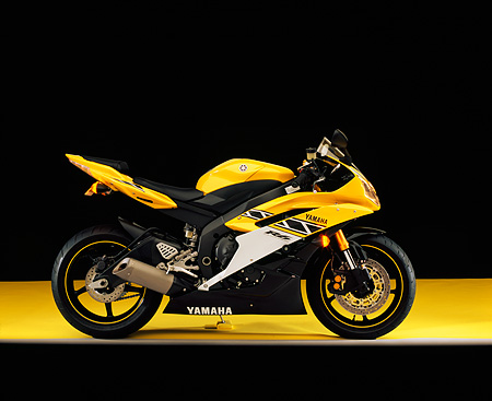MOT 02 RK0287 02 © Kimball Stock 2006 Yamaha YZF 600 R6 Yellow Profile View On Yellow Floor Studio