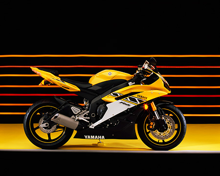 MOT 02 RK0289 03 © Kimball Stock 2006 Yamaha YZF 600 R6 Yellow Profile View On Yellow Floor Colorful Lines Studio