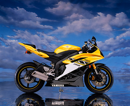 MOT 02 RK0292 09 © Kimball Stock 2006 Yamaha YZF 600 R6 Yellow Profile View Cloudy Blue Sky Studio