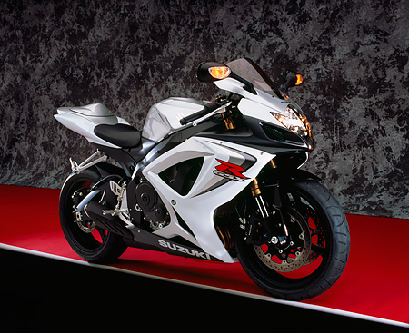 MOT 02 RK0301 06 © Kimball Stock 2006 Suzuki GSXR 600 Silver And White 3/4 Side View On Red Floor Gray Marble Studio
