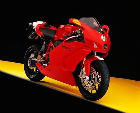 MOT 02 RK0304 06 © Kimball Stock 2005 Ducati 749R Red 3/4 Front View On Yellow Floor Studio