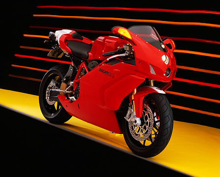 MOT 02 RK0305 05 © Kimball Stock 2005 Ducati 749R Red 3/4 Front View On Yellow Floor Colorful Lines Studio