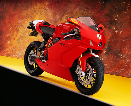 MOT 02 RK0306 07 © Kimball Stock 2005 Ducati 749R Red 3/4 Front View On Yellow Floor  Studio