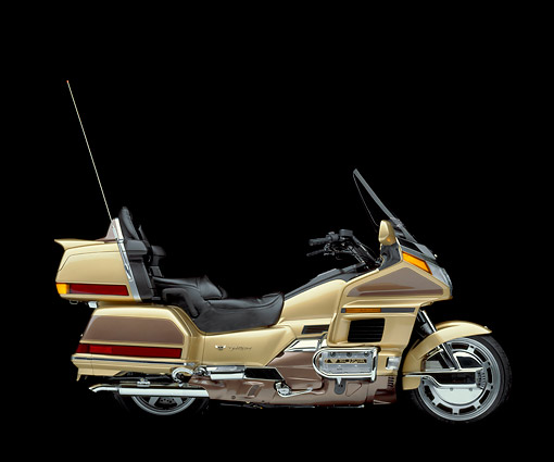 MOT 03 RK0001 02 © Kimball Stock 1991 Honda GoldWing Anniversary Ed. Gold profile in studio on black