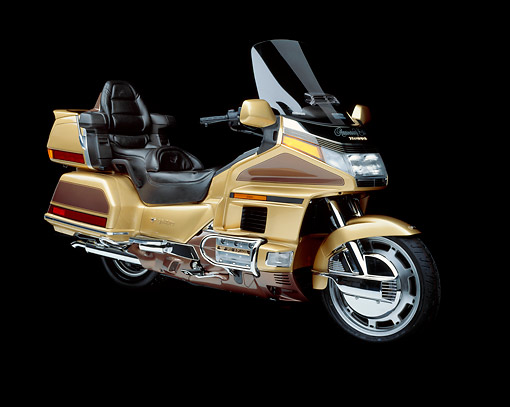 MOT 03 RK0002 04 © Kimball Stock 1991 Honda GoldWing Anniversary Ed. Gold 3/4 front in studio on black