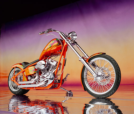 MOT 04 RK0029 01 © Kimball Stock 2004 High Performance Custom Chopper Orange With Flames Low 3/4 View On Mylar Floor Studio