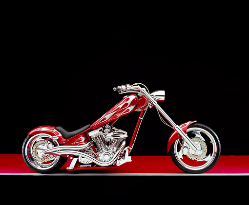 MOT 04 RK0081 04 © Kimball Stock 2003 Iron Horse Texas Chopper Red With Flames Side View On Red Floor Gray Line Studio
