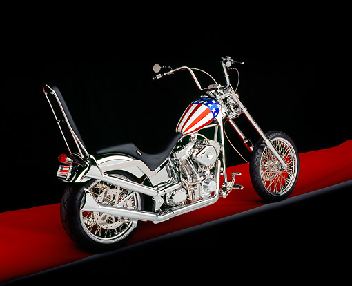 MOT 04 RK0003 02 © Kimball Stock 2004 Captain American II Chopper 3/4 Rear View On Red Floor Studio
