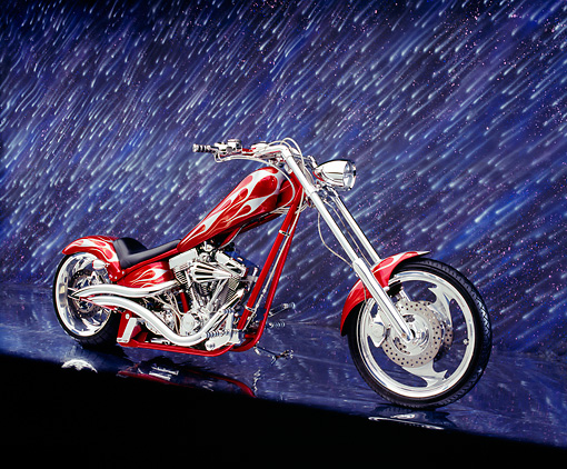 MOT 04 RK0083 02 © Kimball Stock 2003 Iron Horse Texas Chopper Red With Flames 3/4 Side View On Mylar Floor Night Showers