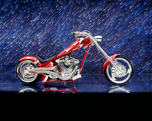 MOT 04 RK0084 02 © Kimball Stock 2003 Iron Horse Texas Chopper Red With Flames Side View On Mylar Floor Night Showers