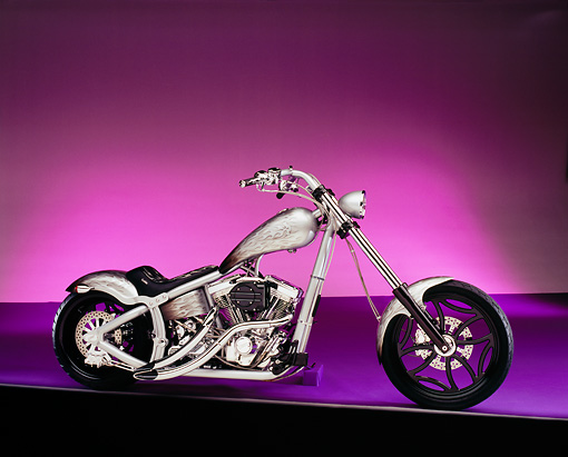 MOT 04 RK0100 01 © Kimball Stock 2003 Swift Bar Chopper Silver Side View Purple Floor And Lighting Studio
