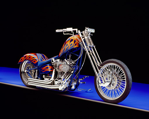 MOT 04 RK0127 06 © Kimball Stock 2005 Fine Line, Chopper, Blue With Flames 3/4 Side View On Purple Floor Studio