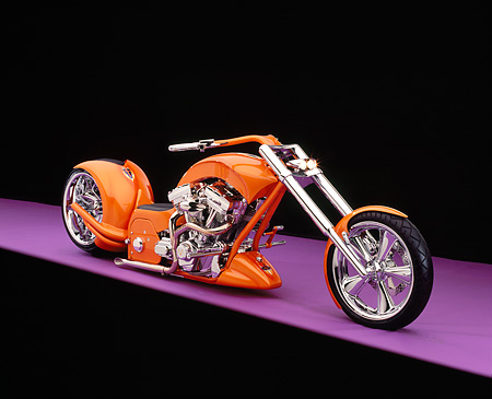 MOT 04 RK0148 07 © Kimball Stock 2006 Brouhard Custom Softail Pearl Orange 3/4 Front View On Purple Floor Studio