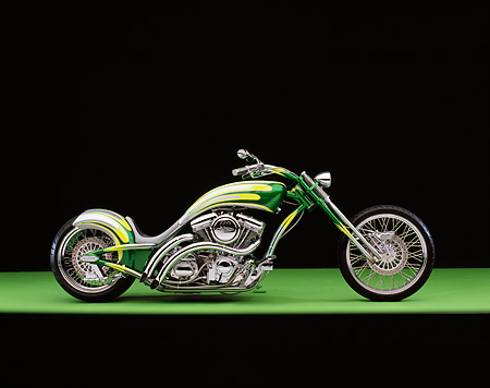 MOT 04 RK0169 06 © Kimball Stock 2006 Redneck Engineering Low Curves Chopper Silver And Green Profile View On Green Floor Studio