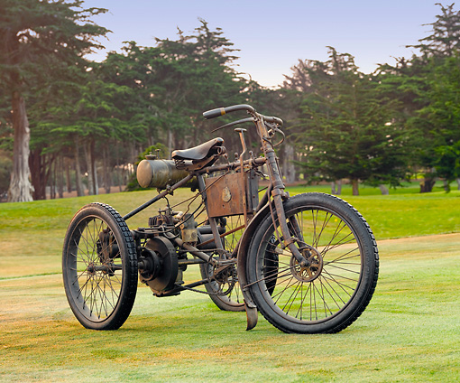 MOT 05 BK0001 01 © Kimball Stock 1899 Peugeot Trike Brown 3/4 Front View On Grass By Trees