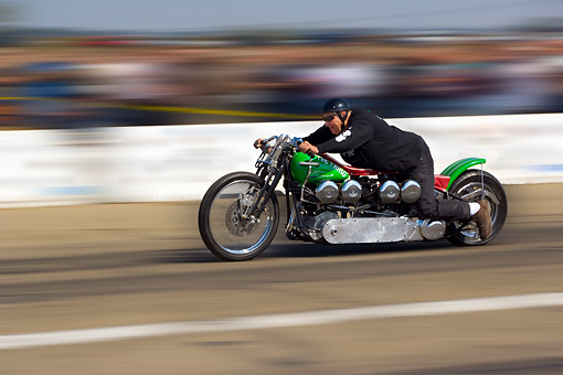 MOT 05 RK0006 01 © Kimball Stock 1947 Harley Davidson Dual Knucklehead Green And Red Side 3/4 View In Motion On Race Track By Start Light