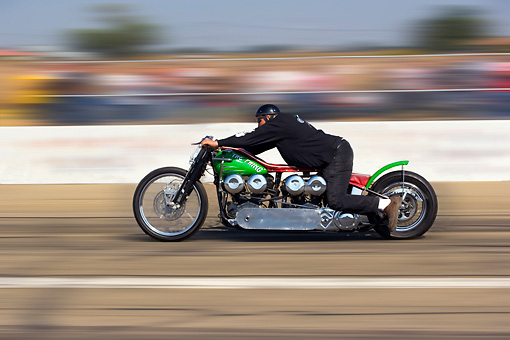 MOT 05 RK0007 01 © Kimball Stock 1947 Harley Davidson Dual Knucklehead Green And Red Profile View In Motion On Race Track By Start Light