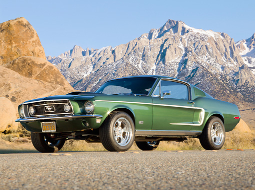 MST 01 BK0001 01 © Kimball Stock 1968 Ford Mustang GT 428 Cobra Jet Highland Green 3/4 Front View On Road By Snowy Mountains