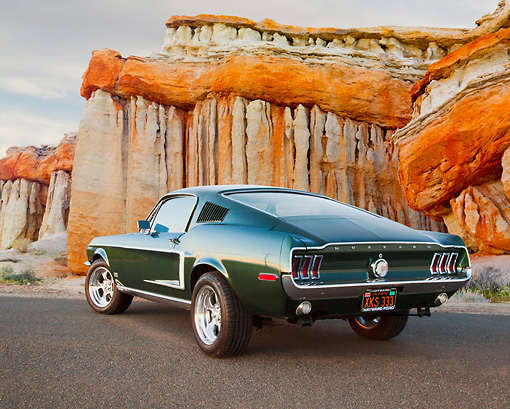 MST 01 BK0004 01 © Kimball Stock 1968 Ford Mustang GT 428 Cobra Jet Highland Green 3/4 Rear View On Pavement By Cliffside