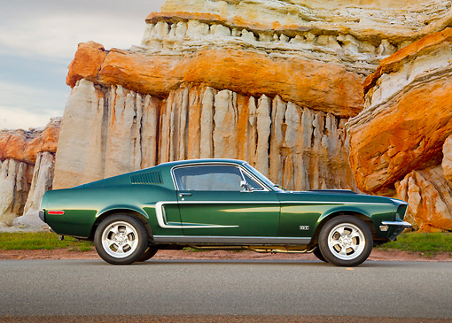 MST 01 BK0005 01 © Kimball Stock 1968 Ford Mustang GT 428 Cobra Jet Highland Green Profile View On Pavement By Cliffside