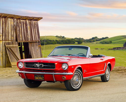 MST 01 BK0008 01 © Kimball Stock 1965 Ford Mustang Convertible Red 3/4 Front View On Gravel By Field And Old Wooden Shed