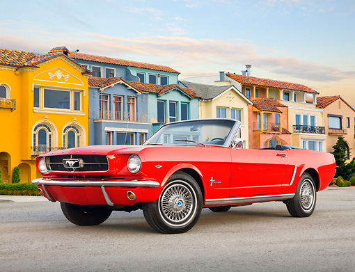 MST 01 BK0011 01 © Kimball Stock 1965 Ford Mustang Convertible Red 3/4 Front View On Pavement By Colorful Houses