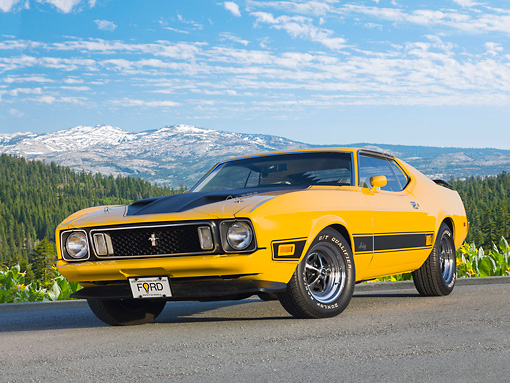 MST 01 BK0015 01 © Kimball Stock 1973 Ford Mustang Mach 1 Grabber Yellow 3/4 Front View On Pavement By Mountains