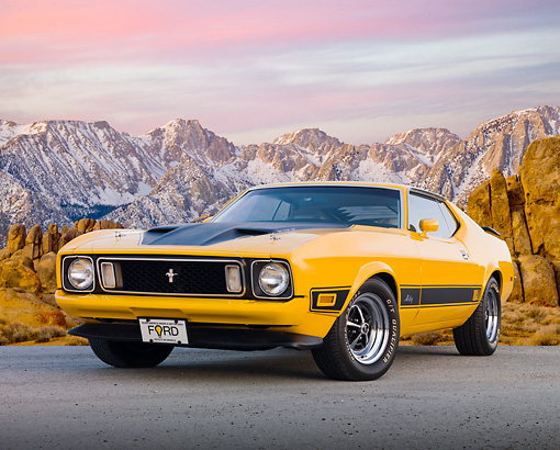 MST 01 BK0016 01 © Kimball Stock 1973 Ford Mustang Mach 1 Grabber Yellow 3/4 Front View On Pavement By Snowy Mountain Peaks