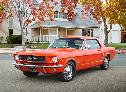 MST 01 BK0061 01 © Kimball Stock 1965 Ford Mustang Poppy Red 3/4 Front View On Pavement By House And Autumn Trees