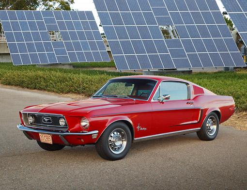 MST 01 BK0080 01 © Kimball Stock 1968 Ford Mustang Fastback Red 3/4 Front View On Pavement By Solar Panels