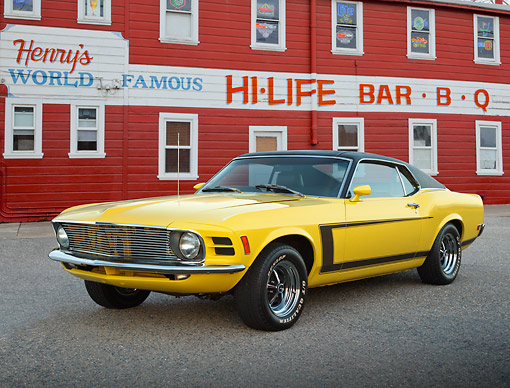 MST 01 BK0094 01 © Kimball Stock 1970 Ford Mustang Grabber Yellow 3/4 Front View On Pavement By Barbeque
