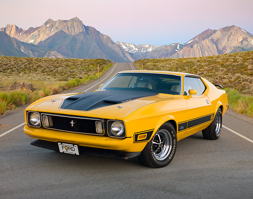 MST 01 BK0102 01 © Kimball Stock 1973 Ford Mustang Mach 1 Grabber Yellow 3/4 Front View On Road By Mountains