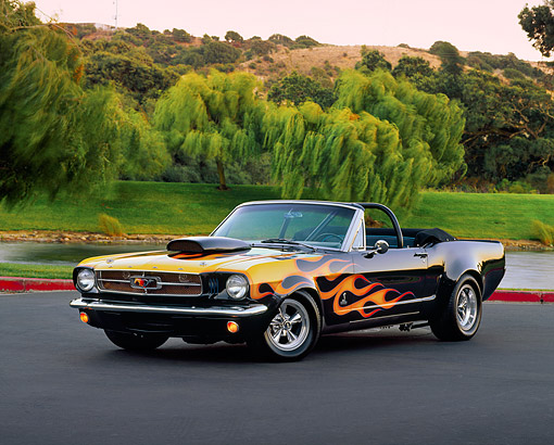 MST 01 RK0437 03 © Kimball Stock 1966 Ford Mustang Custom Convertible Black With Flames 3/4 Front View On Pavement Water Trees