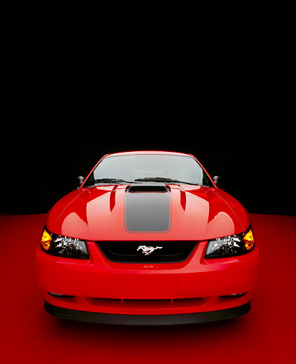 MST 01 RK0600 01 © Kimball Stock 2003 Ford Mustang Mach 1 Coupe Red Wide Angle Head On Shot On Red Floor Studio