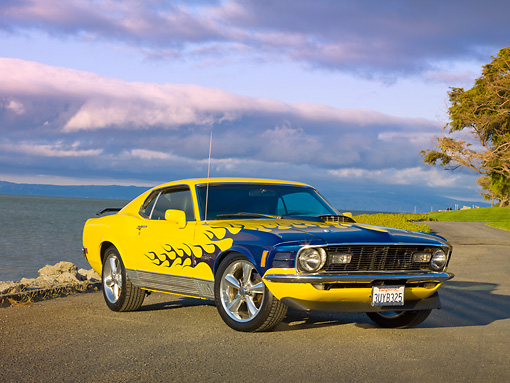 MST 01 RK1166 01 © Kimball Stock 1970 Ford Mustang Mach 1 Yellow With Flames 3/4 Front View On Pavement By Ocean