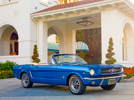 MST 01 RK1185 01 © Kimball Stock 1964 1/2 Ford Mustang Convertible Blue 3/4 Front View On Pavement By Building