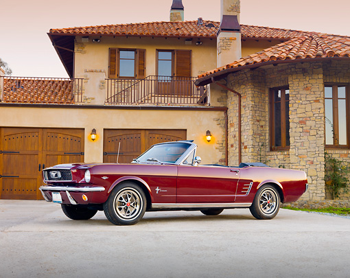 MST 01 RK1210 01 © Kimball Stock 1966 Mustang Convertible Burgundy 3/4 Front View In Front Of House.