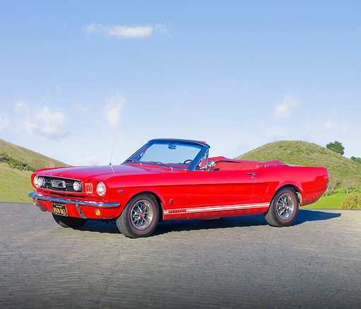 MST 01 RK1215 01 © Kimball Stock 1966 Mustang Convertible Red 3/4 Front View In Front of Hills.