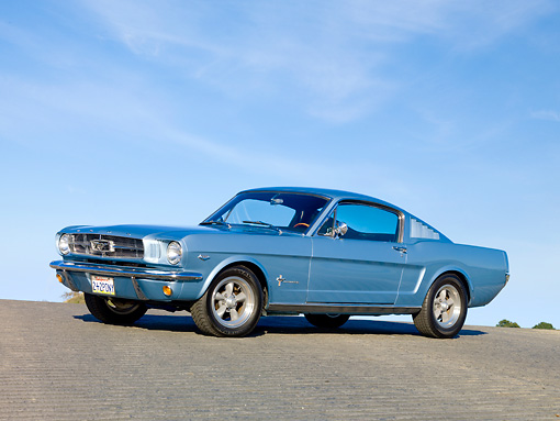 MST 01 RK1216 01 © Kimball Stock 1965 Mustang Fastback Silver-Blue 3/4 Front View On Road