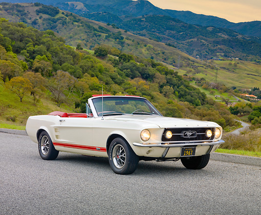 MST 01 RK1220 01 © Kimball Stock 1967 Ford Mustang GTA Convertible White 3/4 Front View On Pavement By Hills
