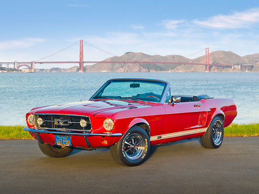 MST 01 RK1377 01 © Kimball Stock 1967 Ford Mustang GTA Convertible Red 3/4 Front View On Pavement By Golden Gate Bridge