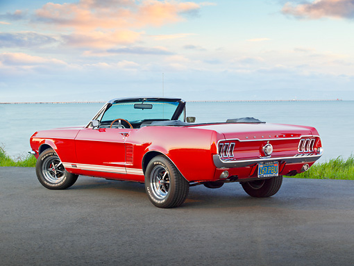 MST 01 RK1395 01 © Kimball Stock 1967 Ford Mustang GTA Convertible Red 3/4 Rear View On Pavement By Water
