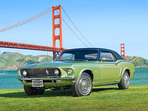 MST 01 RK1445 01 © Kimball Stock 1969 Ford Mustang Grande Lime Gold 3/4 Front View On Grass By Golden Gate Bridge