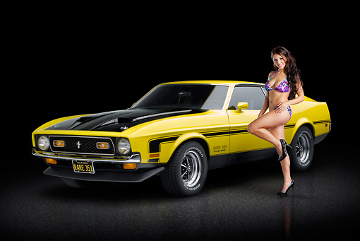 MST 01 RK1468 01 © Kimball Stock 1971 Ford Mustang Boss 351 Yellow 3/4 Front View On Pavement With Swimsuit Model