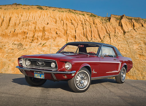 MST 01 RK1496 01 © Kimball Stock 1968 Ford Mustang Royal Maroon 3/4 Front View On Pavement By Rock Wall