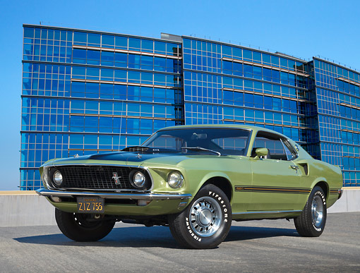 MST 01 RK1511 01 © Kimball Stock 1969 Ford Mustang Mach 1 Lime Gold 3/4 Front View On Concrete By Glass Building