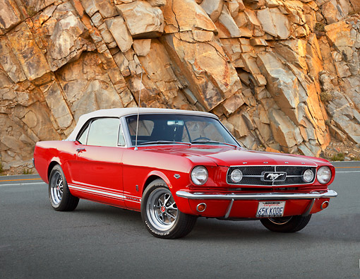MST 01 RK1549 01 © Kimball Stock 1965 Ford Mustang GT Covertible Red With White Top 3/4 Front View On Pavement By Rock Wall