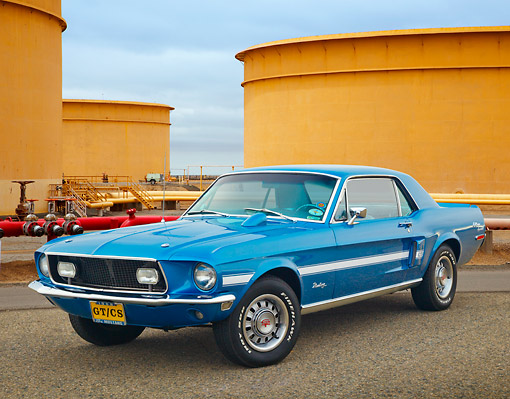 MST 01 RK1591 01 © Kimball Stock 1968 Ford Mustang GT/CS Acapulco Blue 3/4 Front View On Pavement By Industrial Area