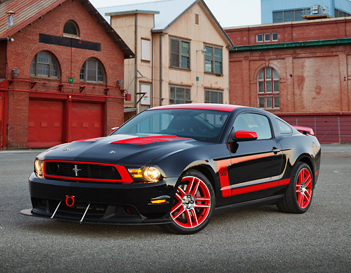 MST 01 RK1637 01 © Kimball Stock 2012 Ford Mustang Boss 302 Laguna Seca Edition Black And Red 3/4 Front View On Pavement By Brick Buildings
