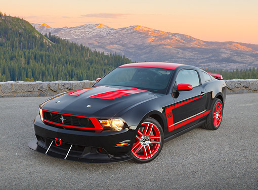 MST 01 RK1639 01 © Kimball Stock 2012 Ford Mustang Boss 302 Laguna Seca Edition Black And Red 3/4 Front View On Pavement In Mountains At Dusk
